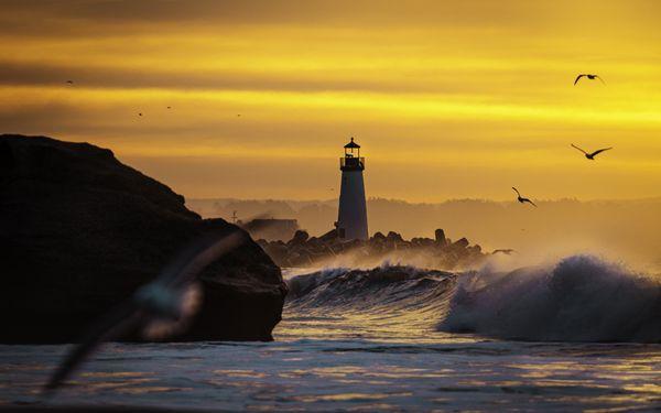 Sunrise over the Walton Lighthouse in Santa Cruz.