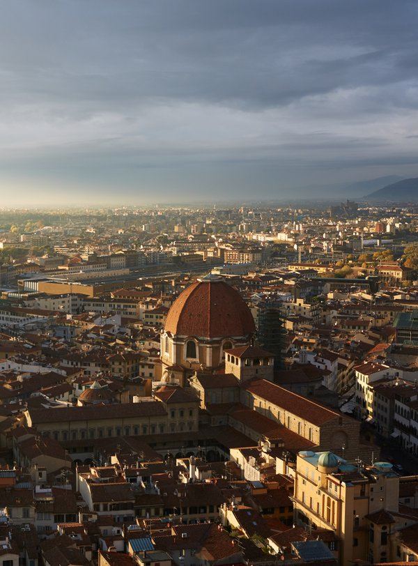 Sun breaking through the clouds on top of the Duomo in Florence thumbnail
