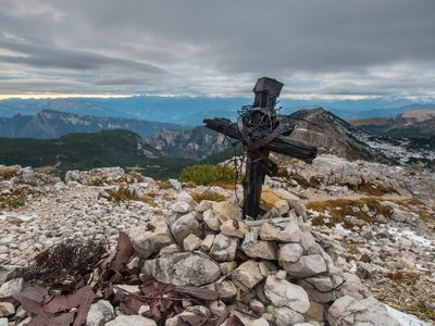 """A cross marks the Austrian line in the Pasubio mountains, a relic of their 1916 """"Punishment Expedition."""""""