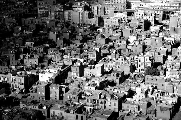 slum district in Cairo with satellite dish thumbnail