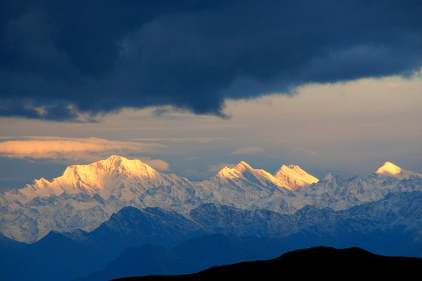 The first ray of the sun fall on the peaks of Himalaya. thumbnail
