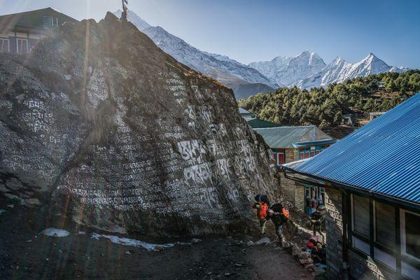 Porters shuffling gear along the Everest Base Camp trail. thumbnail