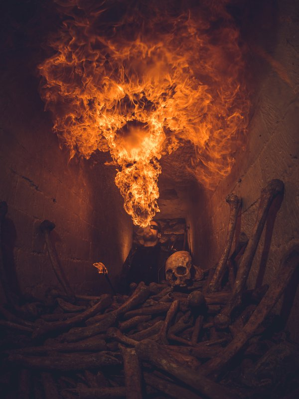 a firebreather in the parisian catacombes thumbnail