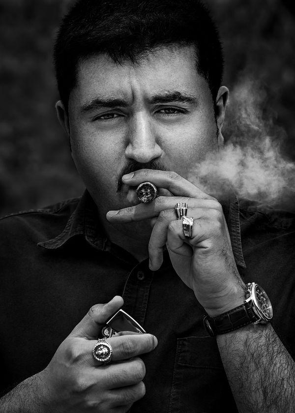 Man smoking a cigar thumbnail