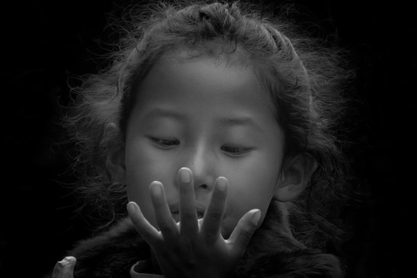 A Young Girl Looking at her Hands thumbnail