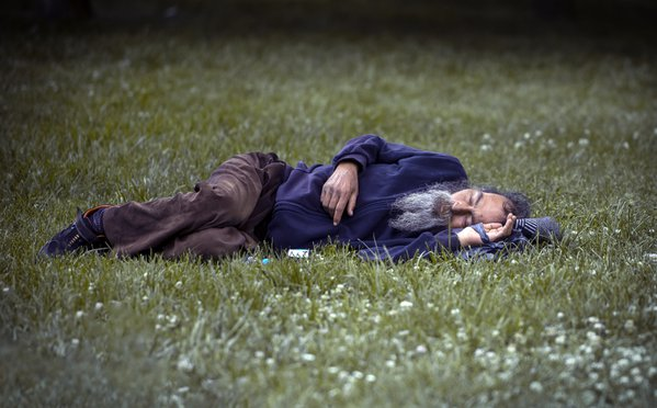 Man sleeping in the garden of the mosque. thumbnail