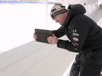 Zach Lund, a former Olympian and head driving coach for the U.S. bobsled team, films an athlete training in Lake Placid, N.Y. for the Sochi Olympics using Ubersense, an app that allows for real-time video analysis.