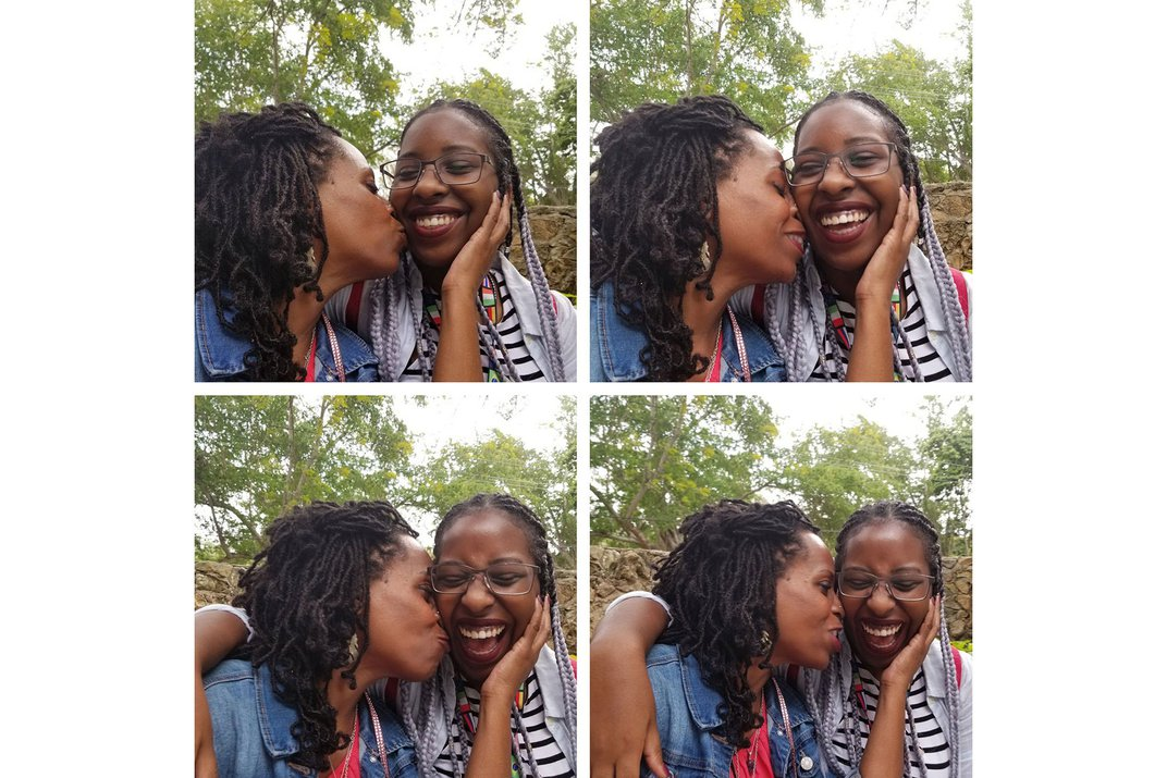 Grid of four images taken in succession: a mother kissing her daughter's cheek and holding her head, while the daughter smiles and laughs.