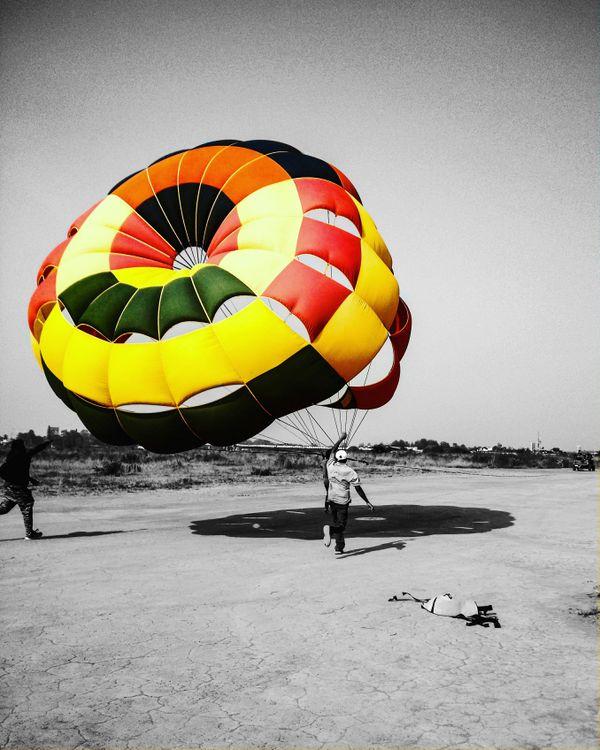 A parachute taking flight. thumbnail