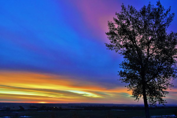 A sunrise with a rainbow array of colors in North Dakota. thumbnail