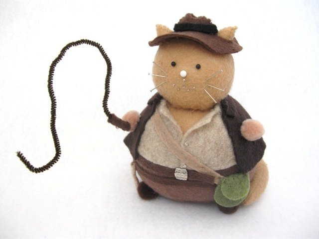 Indiana Jones Cat doesn't mind snakes so much.