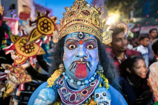 A street artist dressed up as Goddess Kali thumbnail