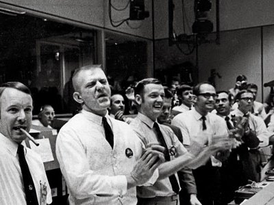 """Gene Kranz (in vest, as Apollo 13 safely splashed down) had faith that """"as a group, we were smart enough ... to get out of any problem."""