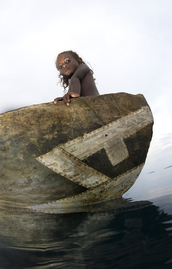 A young village girl in her canoe in the Solomon Islands. thumbnail