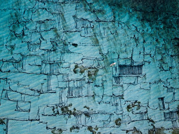 An abstract aerial view of the dying traditional seaweed industry in the Balinese island- Nusa Lembongan. thumbnail