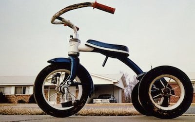 """""""A Democracy of Images,"""" open today at the American Art Museum, features 113 images that span the history of American photography, including William Eggleston's Tricycle (Memphis), c. 1975."""