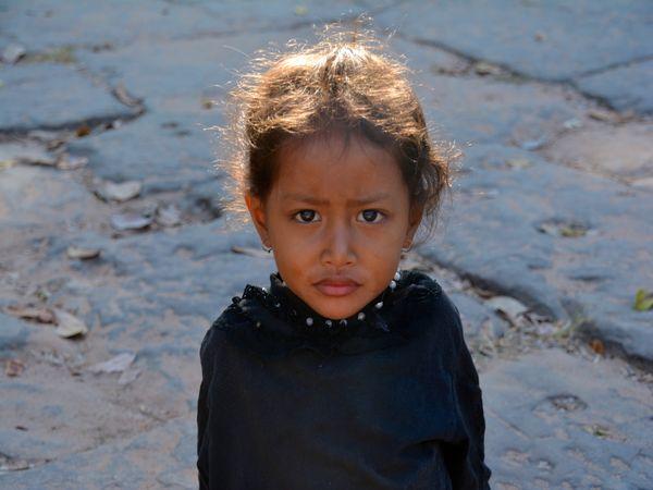 Young girl outside Angkor Wat thumbnail