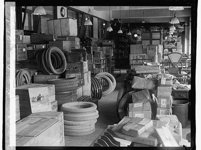 The dead letter office circa 1922. The contents of unresolvable dead letters and packages are periodically sold off by the USPS.