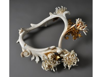 Marion's Morifolium Neckpiece  by Jennifer Trask, 2011, includes sewing needles, antler, various teeth and bones and cast resin with bone powder, among other materials.
