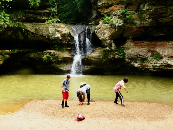 Three Boys Skipping Stones at Hocking Hills, Ohio thumbnail