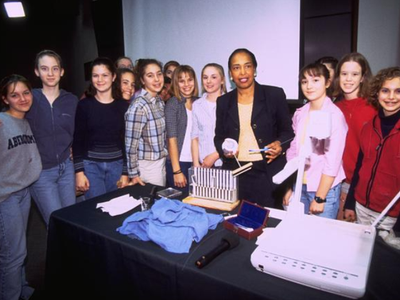 Ophthalmologist Dr. Patricia Bath poses with students at the National Museum of American History in 2000.