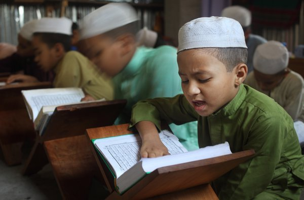 A dedicated child student of Madrasa  thumbnail