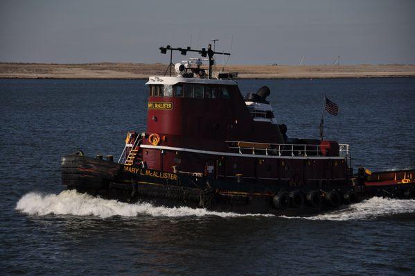 a tug boat in on elizabeth river in norfolk,va. thumbnail