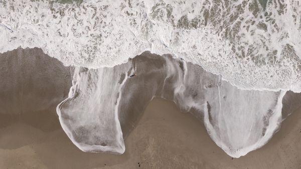 Waves crashing on beach thumbnail