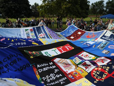 Today, the AIDS Memorial Quilt numbers more than 50,000 panels that honor the lives of some 105,000 people who died of AIDS.