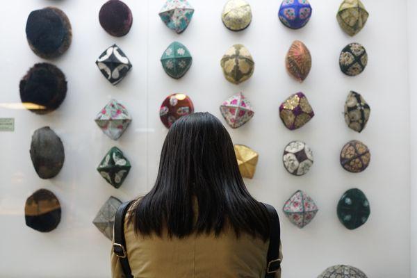 Woman looking at Uighur hats thumbnail