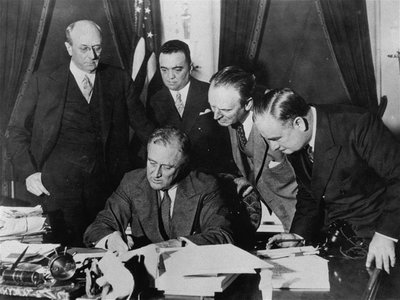 President Franklin D. Roosevelt signing a bill that gave J. Edgar Hoover and the FBI enormous power, in 1934. The bureau has been heavily involved in politics since its origin.