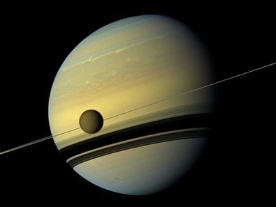 A natural color view of Titan and Saturn taken by NASA's Cassini spacecraft wide-angle camera on May 6, 2012, at a distance of approximately 483,000 miles (778,000 kilometers) from Titan.