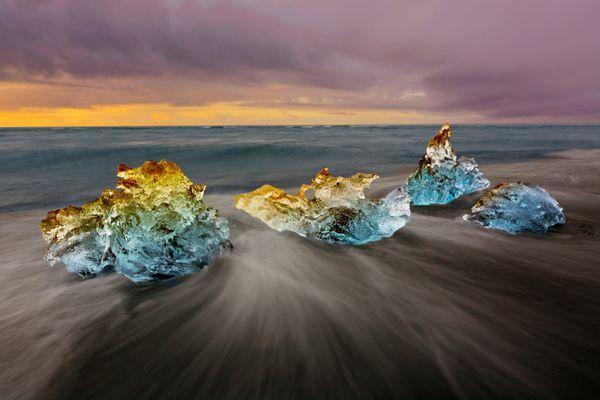 Icebergs in the surf at dawn on Diamond beach, Iceland thumbnail