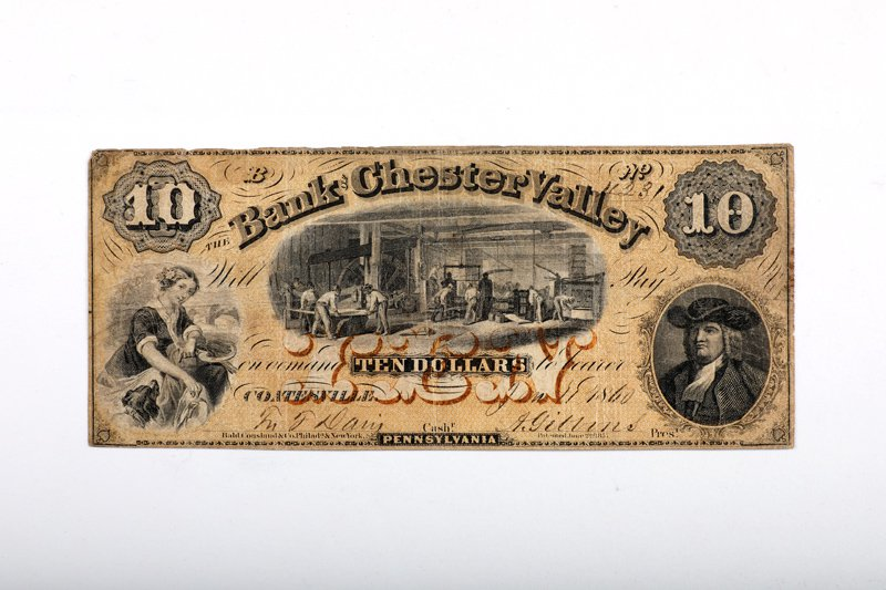 Banknote with print of mill in center