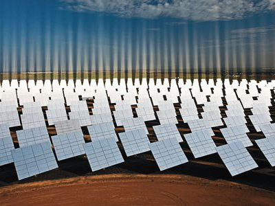The Solúcar facility's acres of heliostats, or mirrors, focus the sun's rays to create temperatures of 570 degrees, generating energy but not harmful emissions.