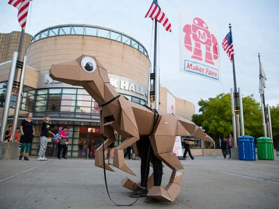 An open source cardboard dino from KitRex stands outside the New York Hall of Science during the World Maker Faire in September 2014.