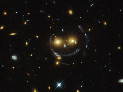 These galaxies are smiling at you thanks to general relativity.