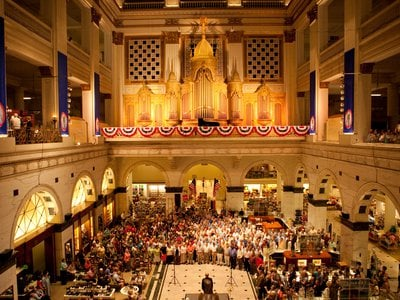Visitors enjoying the sounds of the Wanamaker Organ in the Grand Court at Macy's in Philadelphia.