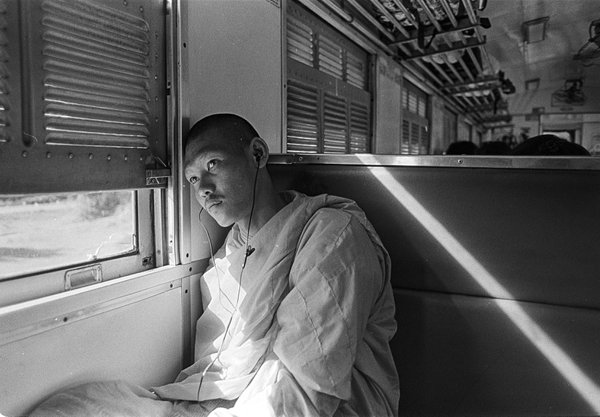 Portrait of a monk in a train in Thailand thumbnail