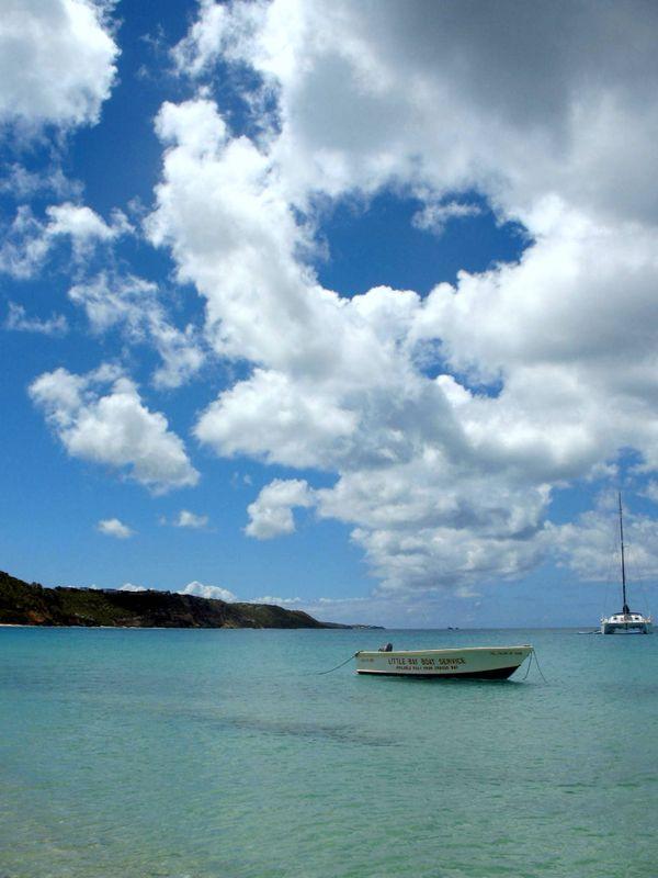 Boat floating in sunshine. thumbnail