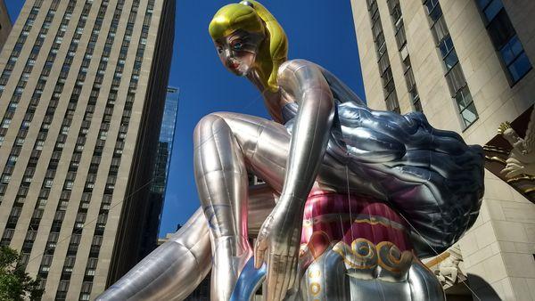 Jeff Koons ballarine balloon while walking Rockerfeller center thumbnail
