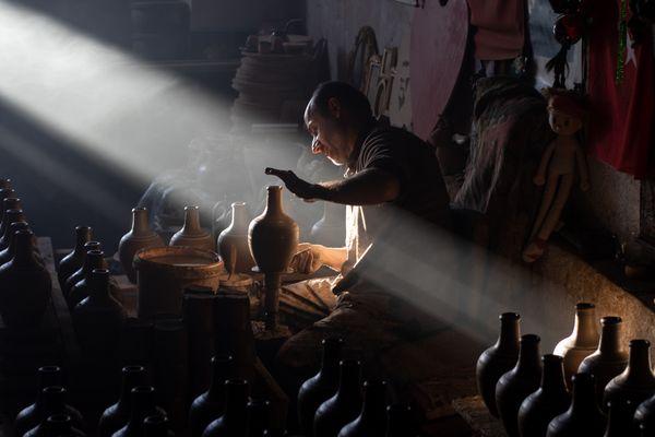Potter in his studio thumbnail