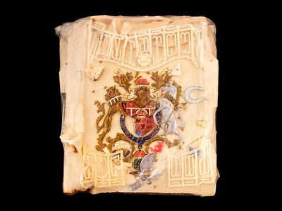 This slice of marzipan was likely cut from the top or side of a single-tier cake sent to Clarence House for the enjoyment of the queen mother's staff.