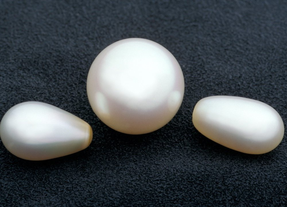 Smooth pearls in the shape of orbs and ovals are usually created by bivalves, like mussels, in pearl farms. As with all gems, the less blemishes they have, the more valuable they are. (Chip Clark, Smithsonian)