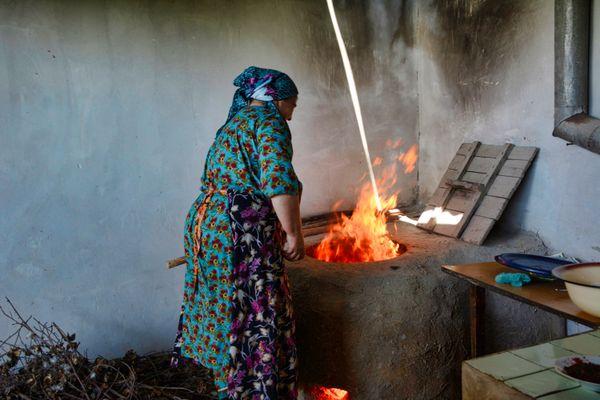 Woman baking bread, Samarkand, UZ thumbnail