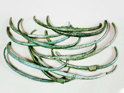 Similar in weight and appearance, these Bronze Age ribs, or curved rods, may have been used as an early form of money.