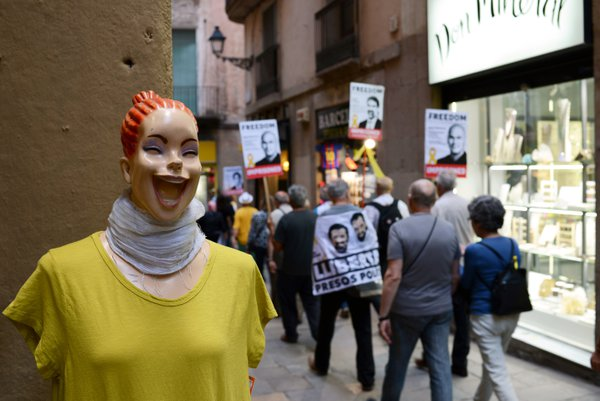 Laughing mannequin wearing yellow t-shirt as people in Barcelona protest to free the political prisoners, - Catalan pro-independence leaders in jail and abroad.  thumbnail