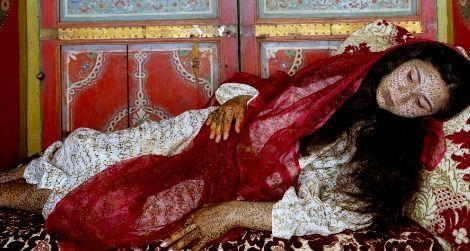 Lalla Essaydi's photographic series challenge traditional ideas of femininity and empowerment