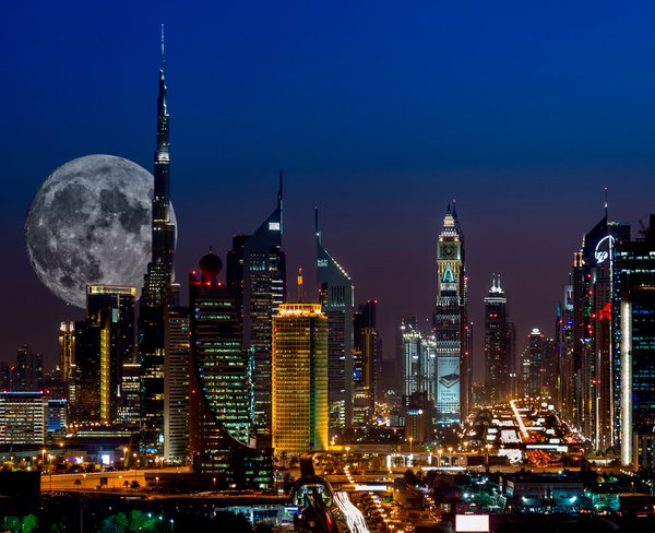 Big moon shining on Burj Khalifah - Dubai thumbnail