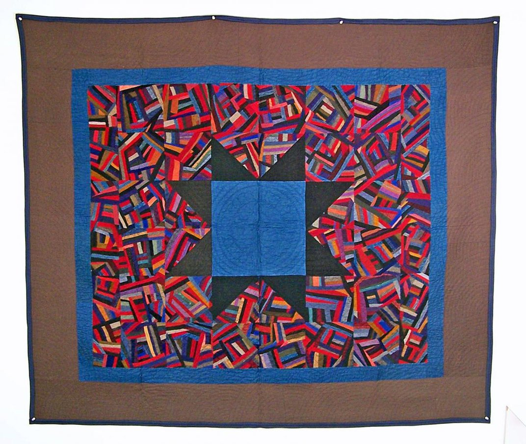 Colorful handmade quilt with a star motif.